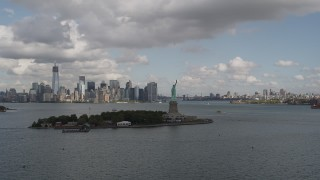 AX87_005 - 4K stock footage aerial video Approach Statue of Liberty, Lower Manhattan skyline, New York, New York