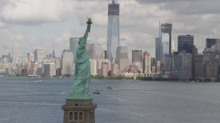 AX87_011 - 4K stock footage aerial video Flying by Statue of Liberty, revealing Lower Manhattan skyline, New York, New York