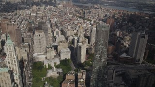 AX87_019 - 4K stock footage aerial video Fly over Lower Manhattan skyscrapers, New York City Hall, New York, New York