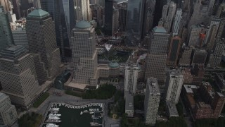 AX87_032 - 4K stock footage aerial video Flying by the World Trade Center Memorial, Lower Manhattan, New York, New York