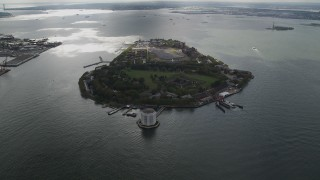 AX87_040 - 4K stock footage aerial video Approaching Governors Island, New York Bay, New York, New York