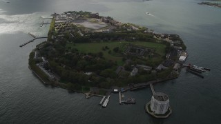 AX87_041 - 4K stock footage aerial video Flying by Governors Island, New York Bay, New York, New York