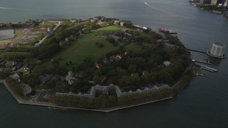 AX87_042 - 4K stock footage aerial video Flying by Governors Island, New York Bay, New York, New York