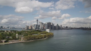 AX87_044 - 4K stock footage aerial video Flying by Lower Manhattan skyline, from  Governors Island, New York, New York