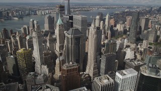 AX87_049 - 4K stock footage aerial video Flying over Lower Manhattan skyscrapers, New York, New York