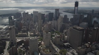 AX87_056 - 4K stock footage aerial video Flying over Lower Manhattan, approaching 8 Spruce Street, New York, New York