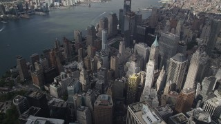 AX87_061 - 4K stock footage aerial video Flying away from skyscrapers in Lower Manhattan, New York, New York