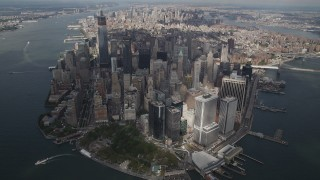 AX87_064 - 4K stock footage aerial video Tilt up to reveal Lower Manhattan from a high altitude, New York, New York