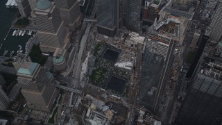 AX87_069 - 4K stock footage aerial video Tilt down on World Trade Center Memorial, Lower Manhattan, New York, New York