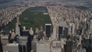 AX87_079 - 4K stock footage aerial video Tilt up from Midtown skyscrapers, revealing Central Park, New York, New York