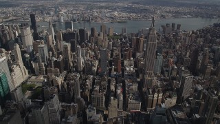 AX87_103 - 4K stock footage aerial video Flying by the Empire State Building, Midtown Manhattan, New York, New York