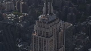 AX87_108 - 4K stock footage aerial video Flying by top decks of Empire State Building, Midtown Manhattan, New York