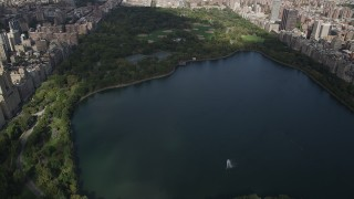 AX87_122 - 4K stock footage aerial video Flying over Jacqueline Kennedy Onassis Reservoir, Central Park, New York, New York