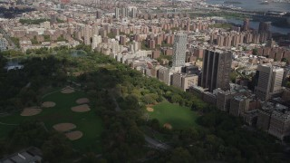 AX87_123 - 4K stock footage aerial video Panning across Upper East Side buildings, Central Park, New York, New York