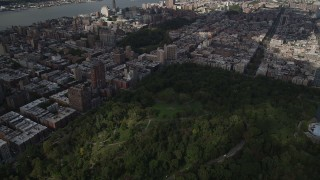AX87_124 - 4K stock footage aerial video Panning left to Upper West Side buildings, Central Park, New York, New York