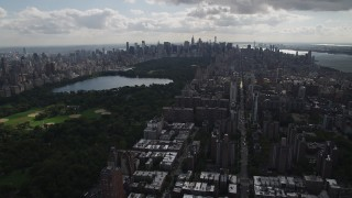 AX87_126 - 4K stock footage aerial video Flying away from Central Park, Upper West Side, New York, New York