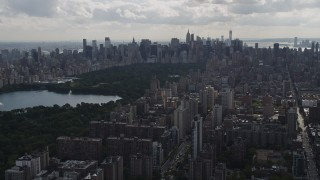 AX87_127 - 4K stock footage aerial video Flying away from Central Park, Upper West Side, New York, New York