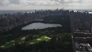 AX87_130 - 4K stock footage aerial video Flying by Central Park, New York, New York