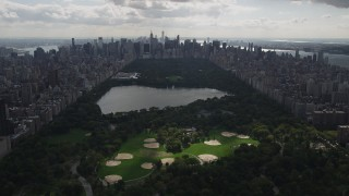 AX87_131 - 4K stock footage aerial video Flying by Central Park, seen from Harlem, New York, New York
