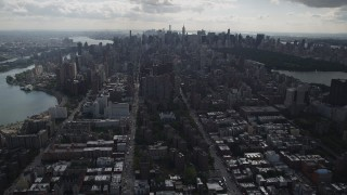AX87_133 - 4K stock footage aerial video Flying over apartment buildings, Upper East Side, Midtown Manhattan, New York