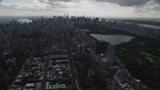 AX87_135 - 4K stock footage aerial video Flying by the Upper East Side, Central Park, New York, New York