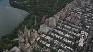 AX87_144 - 4K stock footage aerial video Flying by Upper West Side buildings, New York, New York