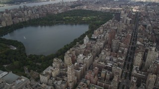 AX87_155 - 4K stock footage aerial video Flying over Upper East Side, Central Park, New York, New York