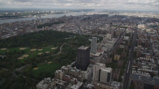 AX87_157 - 4K stock footage aerial video Flying over Upper East Side buildings, Central Park, New York, New York