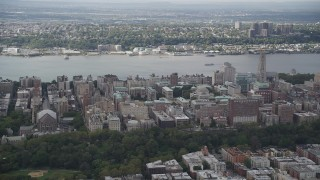 AX87_158 - 4K stock footage aerial video Flying over Columbia University, views of Hudson River, New York, New York
