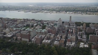 AX87_160 - 4K stock footage aerial video Flying by Columbia University, Morningside Heights, Hudson River, New York