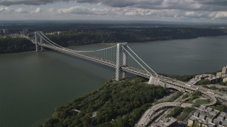 AX87_162 - 4K stock footage aerial video Henry Hudson Parkway, George Washington Bridge, Hudson River, New York