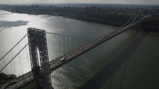 AX87_165 - 4K stock footage aerial video Flying by the George Washington Bridge, Hudson River, New York, New York