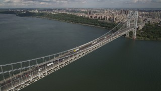 AX87_171 - 4K stock footage aerial video Fly by George Washington Bridge, Hudson River, Washington Heights, New York