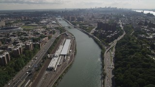 AX87_175 - 4K stock footage aerial video Tilt from Harlem River, Washington Heights, reveal Harlem, New York, New York