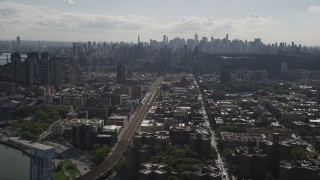 AX87_180 - 4K stock footage aerial video Flying by the Midtown Manhattan skyline, seen from Harlem, New York, New York