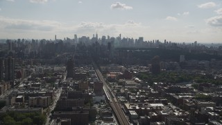 AX87_181 - 4K stock footage aerial video Flying by Midtown Manhattan skyline, seen from Harlem, New York, New York