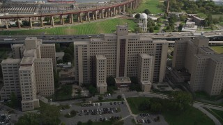 AX87_184 - 4K stock footage aerial video Flying by the Manhattan Psychiatric Center, Wards Island, New York, New York