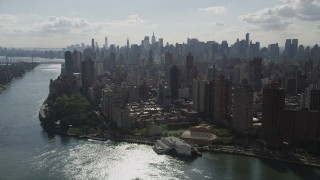 AX87_185 - 4K stock footage aerial video Fly by Midtown Manhattan skyline, from Upper East Side, New York, New York
