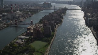 AX87_186 - 4K stock footage aerial video Coler-Goldwater Specialty Hospital, Roosevelt Island, Queensboro Bridge, New York