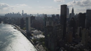 AX87_190 - 4K stock footage aerial video of flying by United Nations, Midtown Manhattan, East River, New York, New York