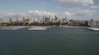 AX88_001 - 4K stock footage aerial video of approaching piers and skyscrapers in Brooklyn, New York