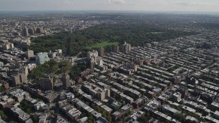 AX88_015 - 4K stock footage aerial video of flying over row houses toward Prospect Park, Grand Army Plaza, Brooklyn, New York
