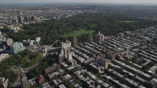 AX88_016 - 4K stock footage aerial video of approach Prospect Park and Grand Army Plaza from row houses, Brooklyn, New York