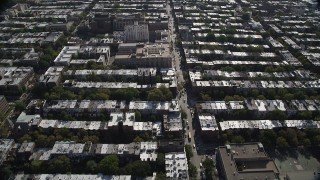 AX88_017 - 4K stock footage aerial video of flying over row houses in urban neighborhoods, Brooklyn, New York