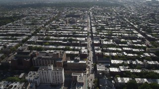 AX88_018 - 4K stock footage aerial video of flying over row houses and city streets in Brooklyn, New York