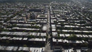 AX88_019 - 4K stock footage aerial video of following a street past row houses near 8th Avenue Armory, Brooklyn, New York