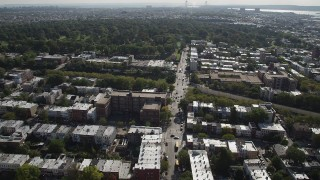 AX88_021 - 4K stock footage aerial video of flying over row houses, approaching Green-Wood Cemetery, Brooklyn, New York