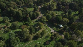 AX88_024 - 4K stock footage aerial video of tilting to graves at Green-Wood Cemetery, Brooklyn, New York