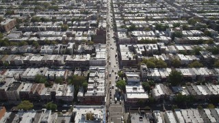 AX88_027 - 4K stock footage aerial video of flying over 8th Avenue and row houses, Brooklyn, New York