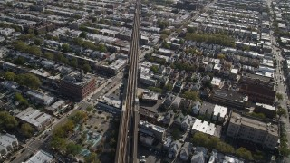AX88_034 - 4K stock footage aerial video of flying by railroad tracks and row houses, Brooklyn, New York